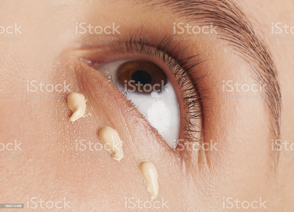 Woman applying foundation royalty-free stock photo