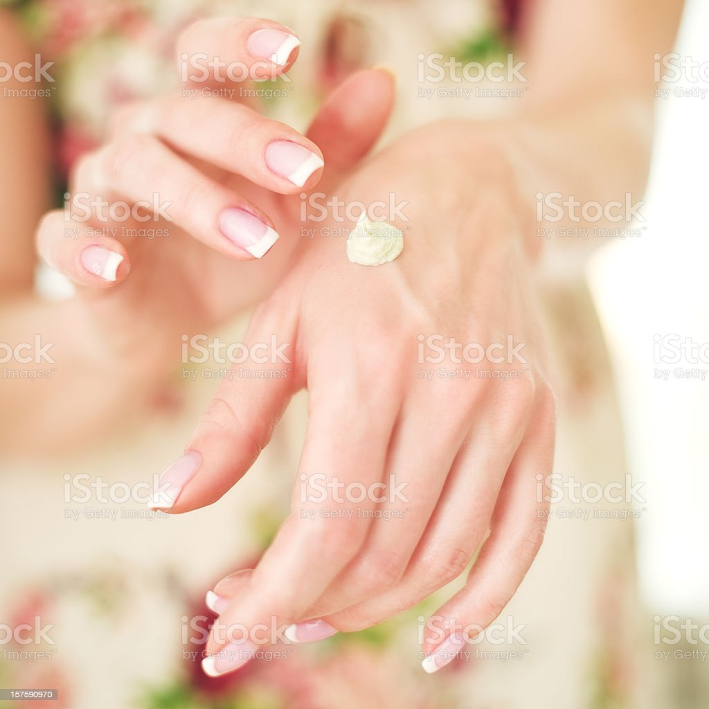 Woman applying hand creme stock photo