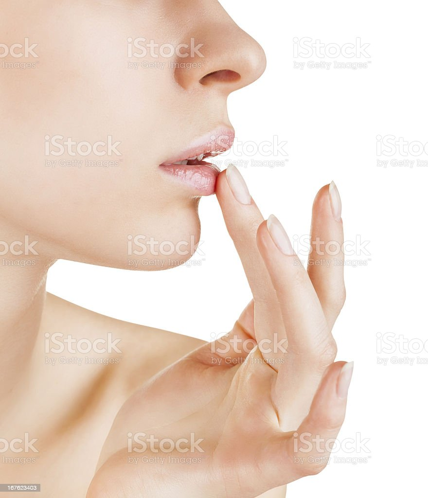 Woman applying lip balm on white stock photo