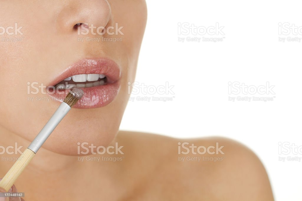 woman applying lip gloss royalty-free stock photo