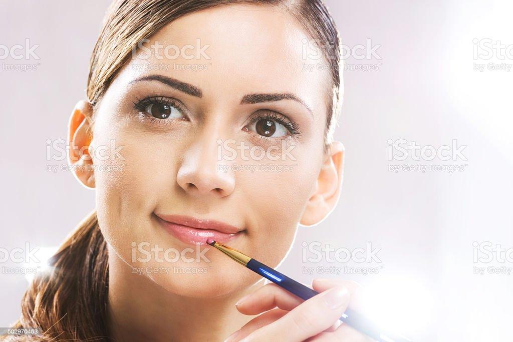 Woman applying lipstick. royalty-free stock photo
