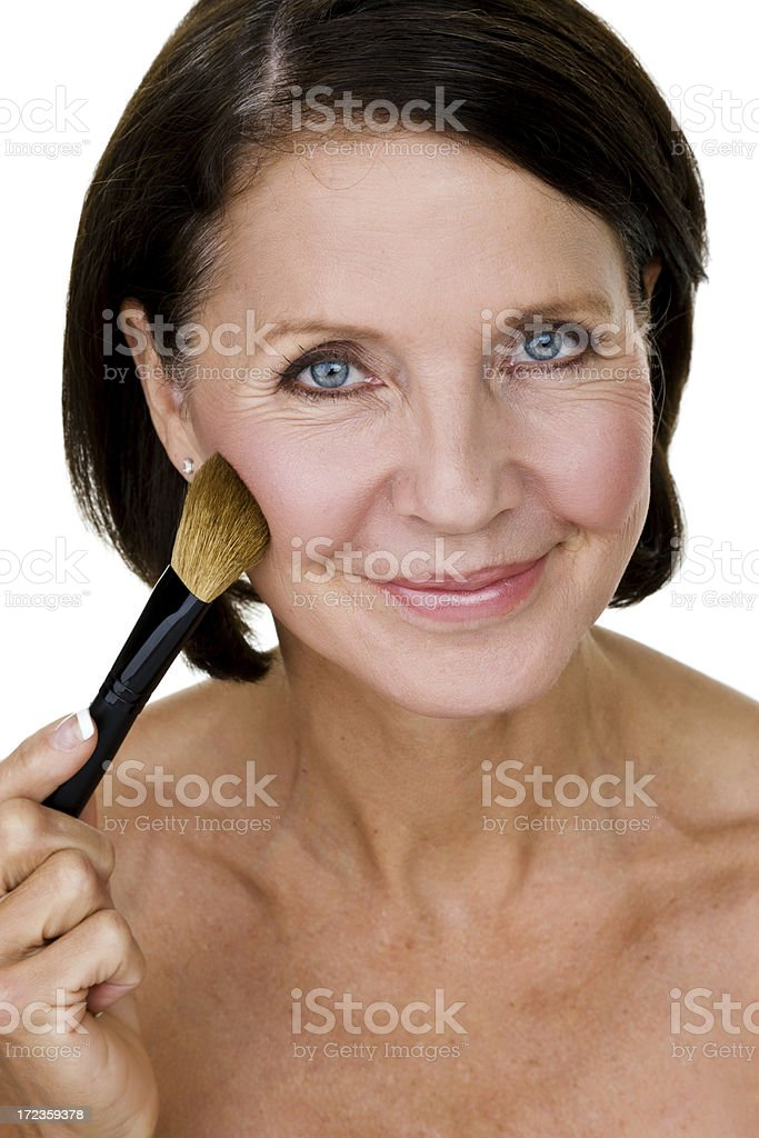 Woman applying makeup royalty-free stock photo