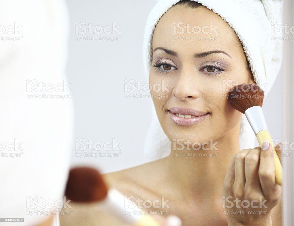 Woman applying makeup. royalty-free stock photo
