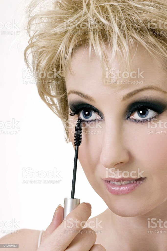 Woman applying mascara royalty-free stock photo