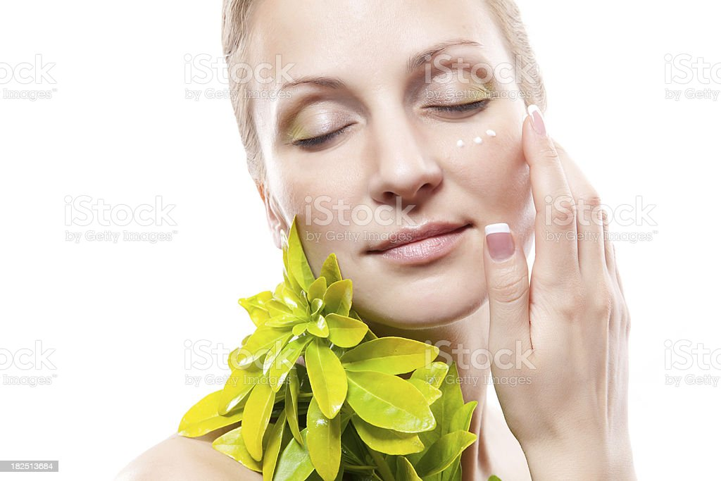 Woman applying moisturizer cream on face royalty-free stock photo