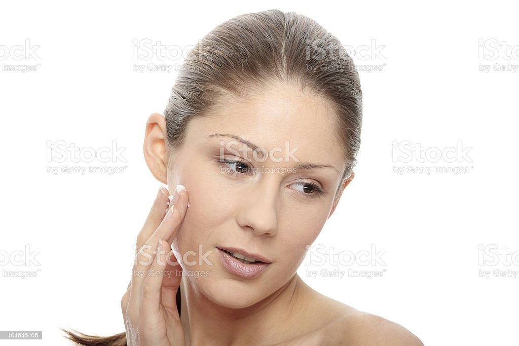 Woman applying moisturizer cream royalty-free stock photo