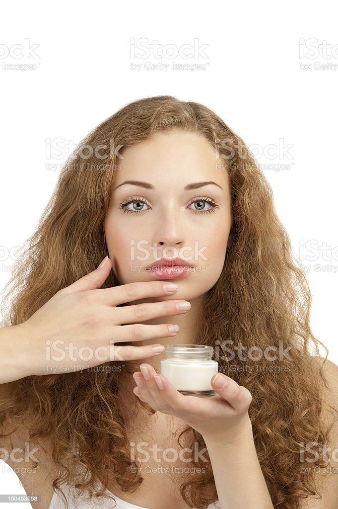 Woman applying moisturizing cream royalty-free stock photo