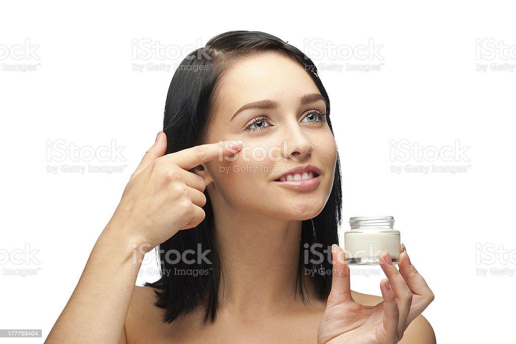 Woman applying moisturizing cream stock photo