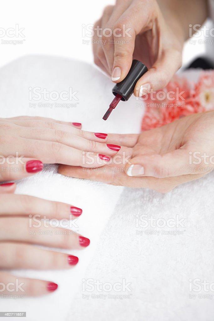 Woman applying nail varnish stock photo