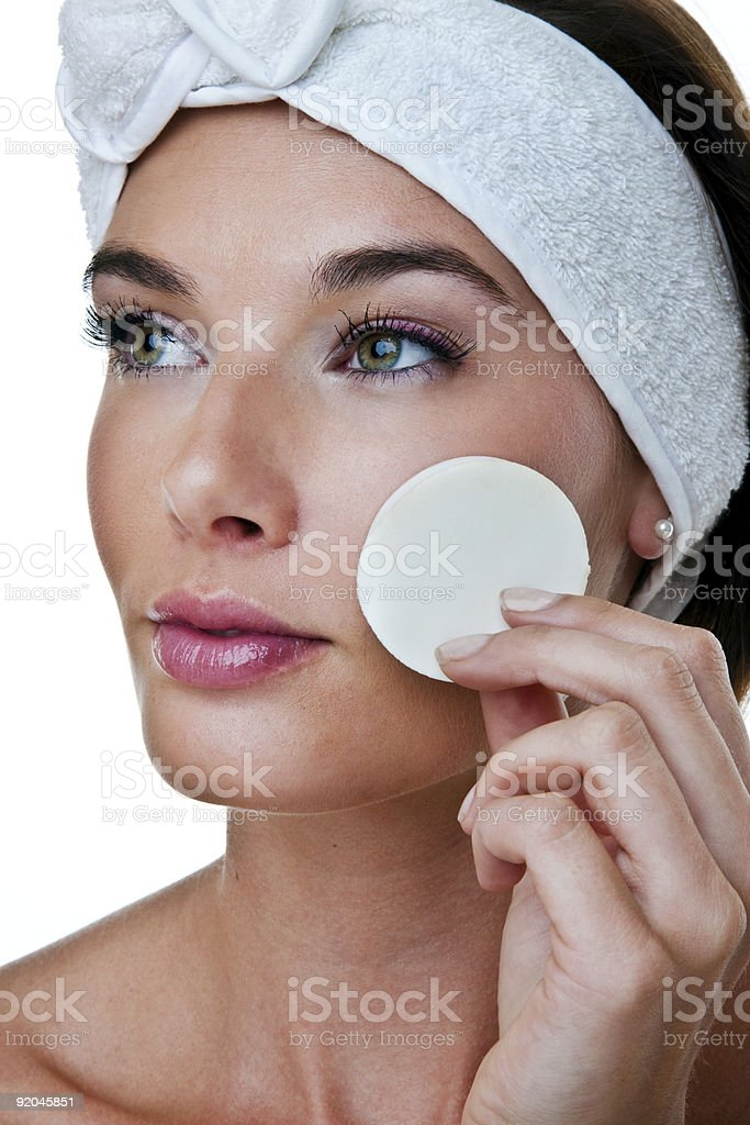 Woman applying or removing makeup royalty-free stock photo