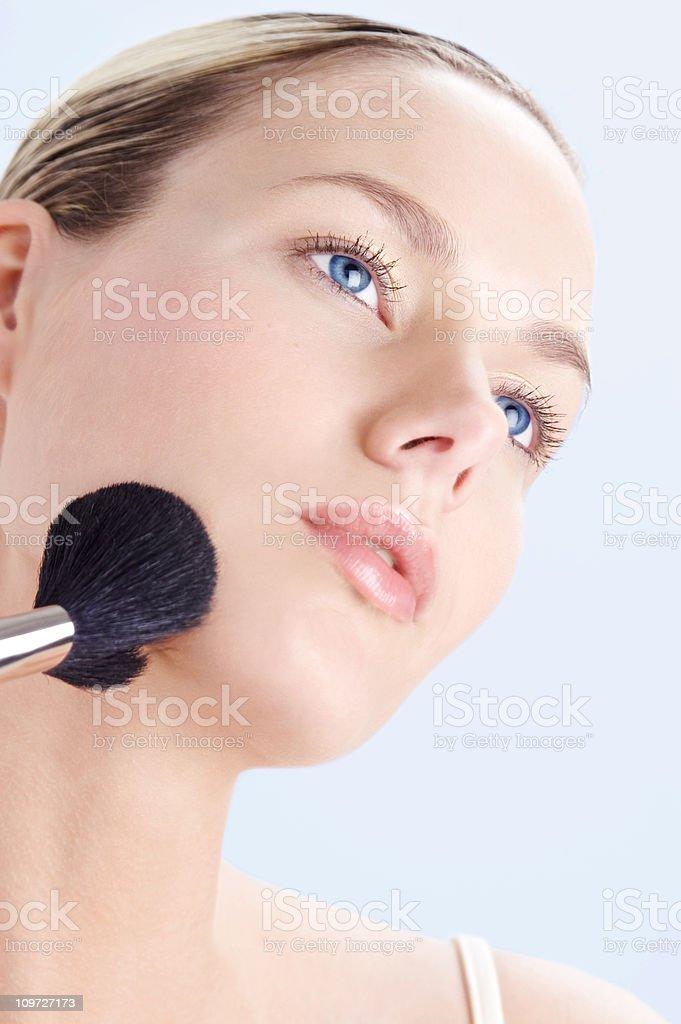 Woman Applying Powder Brush royalty-free stock photo