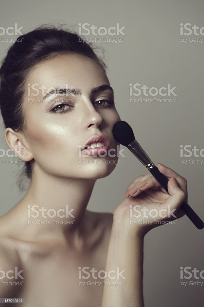 Woman applying rouge royalty-free stock photo