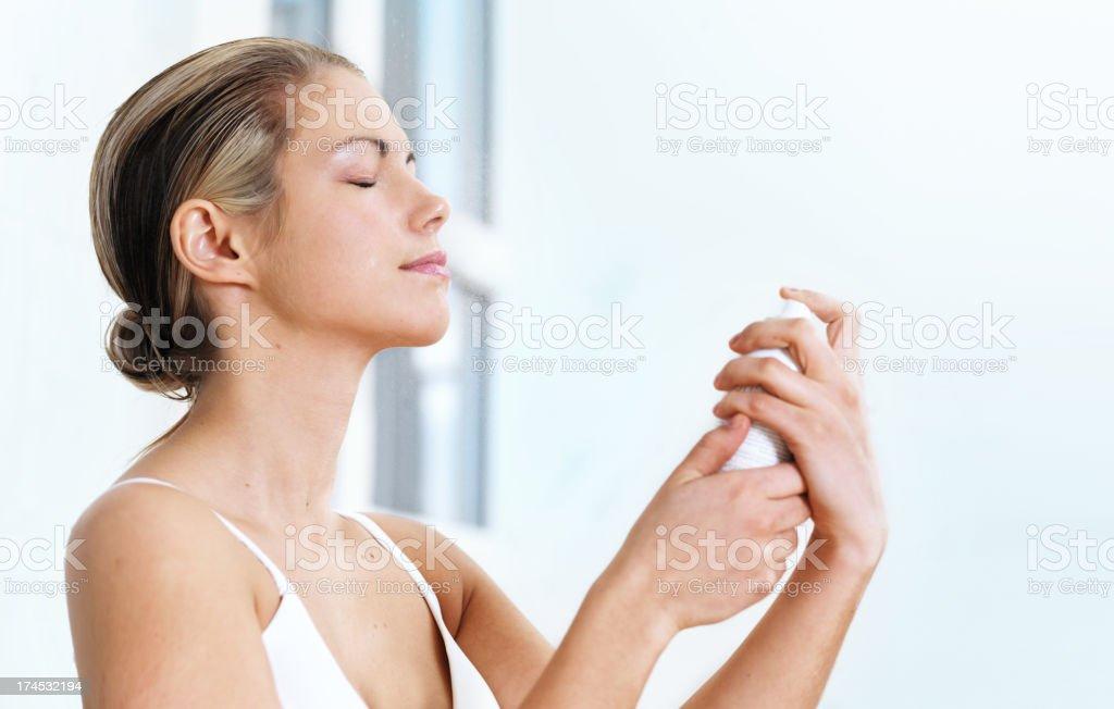 Woman applying water spray stock photo