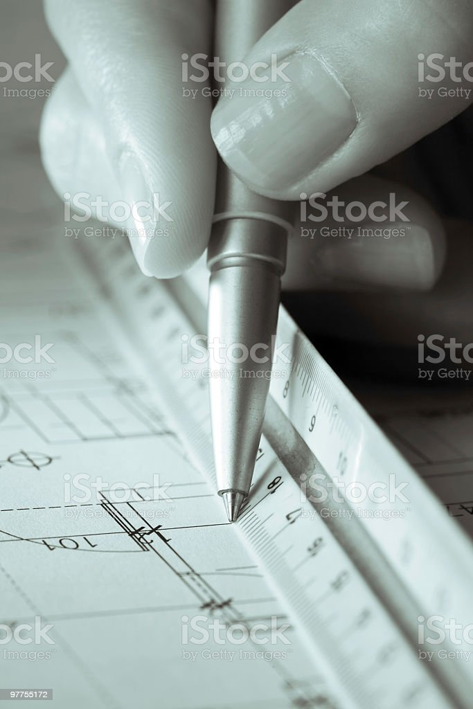 Woman Architect ddesigning an family house blueprint royalty-free stock photo