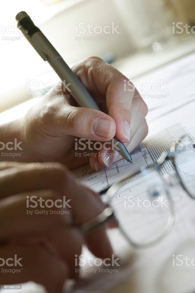 Woman Architect designing an family house blueprint royalty-free stock photo