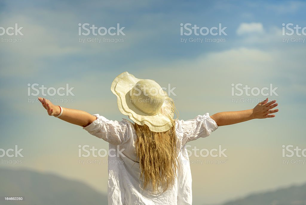 woman arms raised royalty-free stock photo