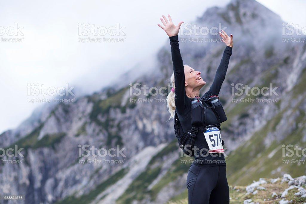Woman arms raised stock photo