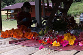 woman arranging and tendering flowers for sale