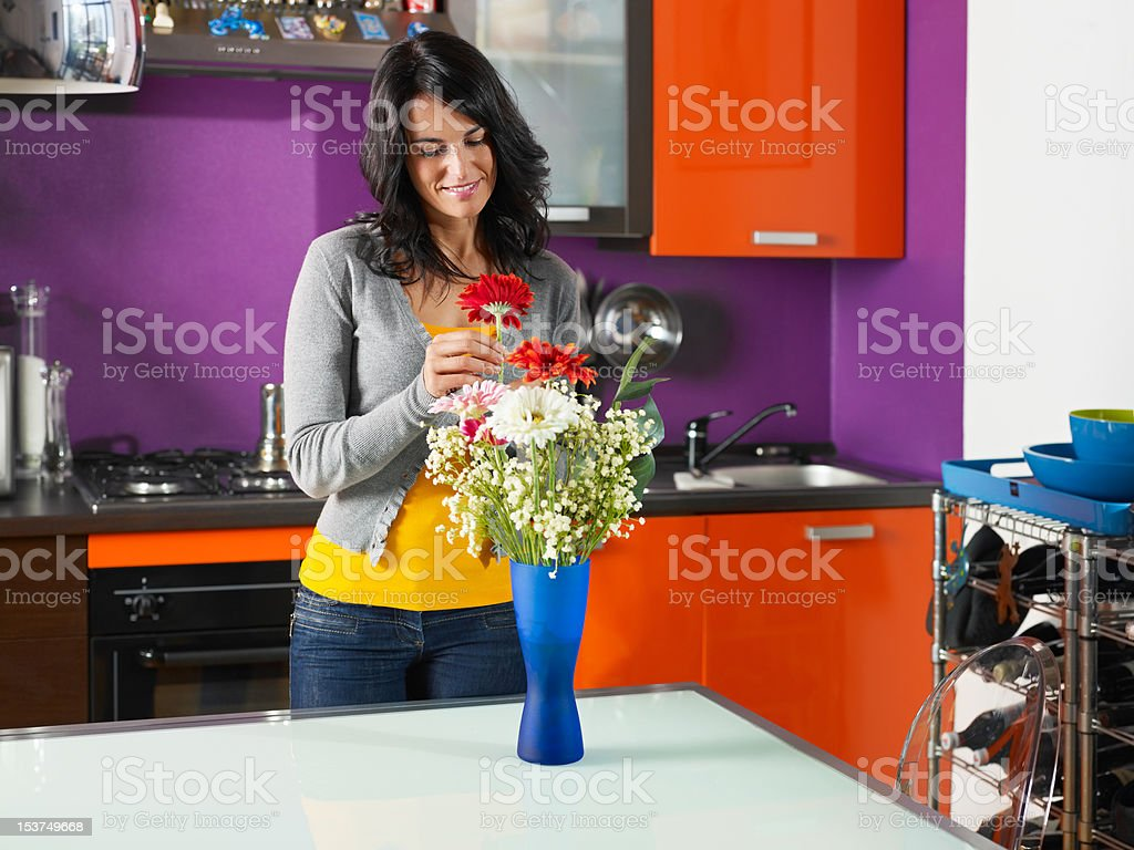 woman arranging flowers in pot royalty-free stock photo