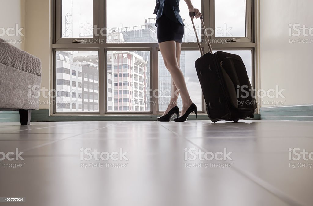 Woman arriving in the new city stock photo