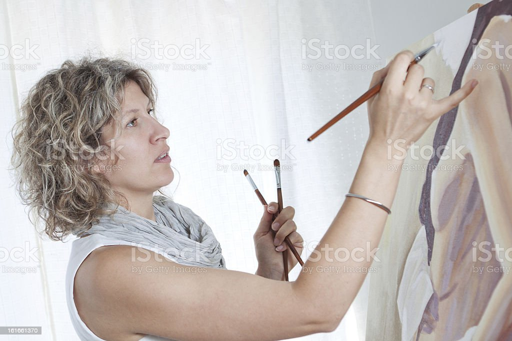 Woman artist draws a portrait of woman. royalty-free stock photo