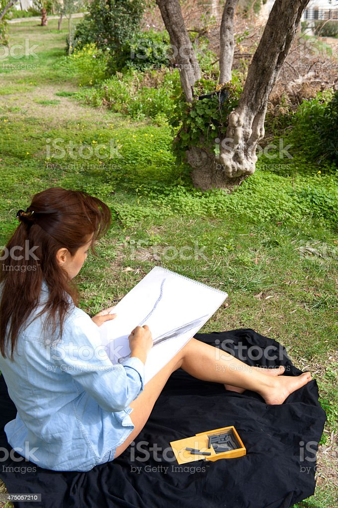 Woman artist sketching stock photo