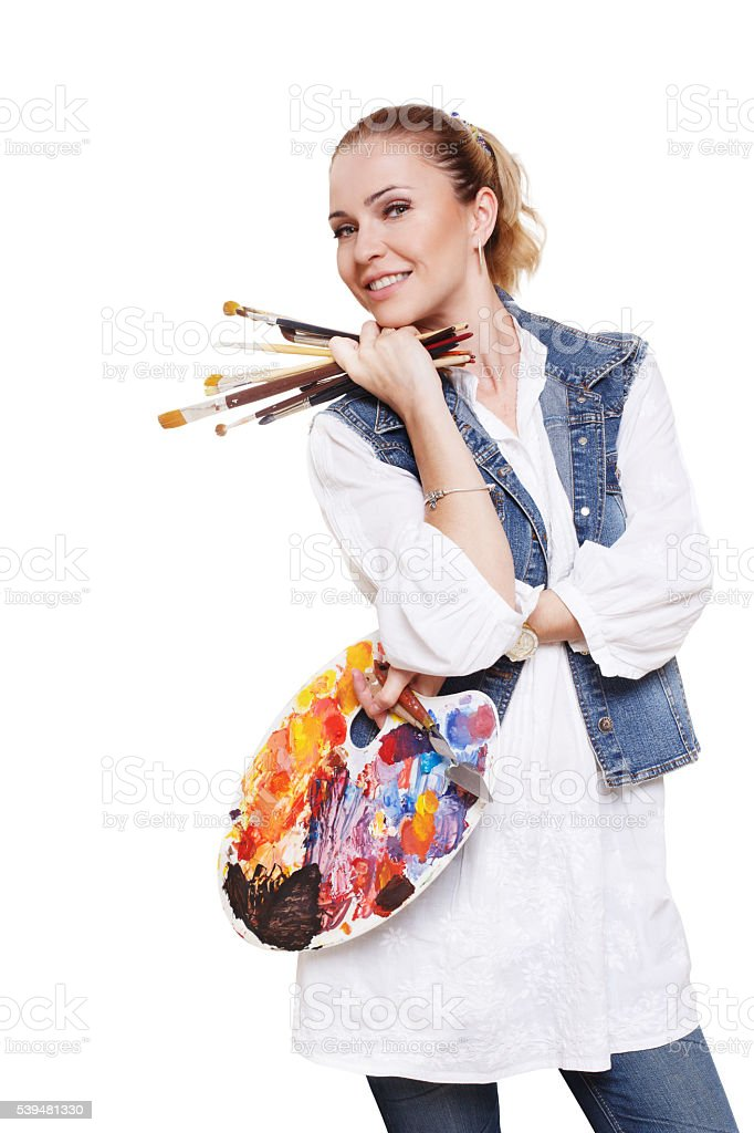 Woman artist with brushes and palette, isolated stock photo