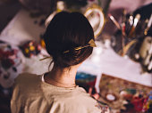 Woman artist working at her studio desk painting