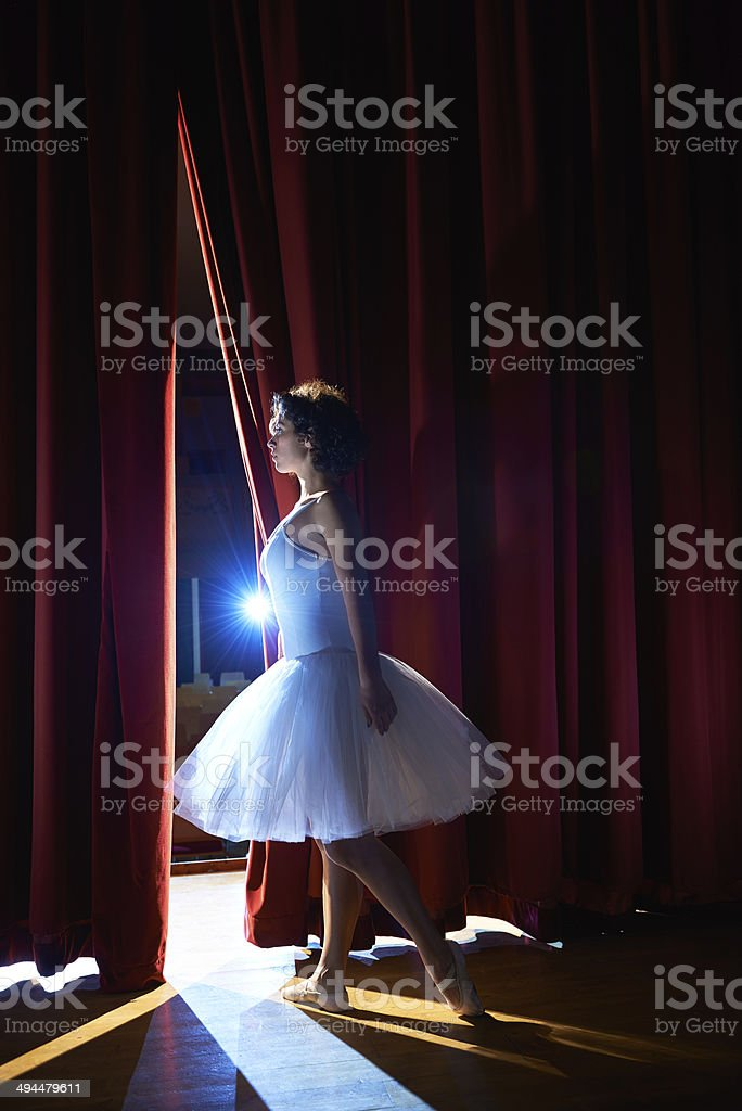 woman as classic dancer looking at stalls before ballet stock photo