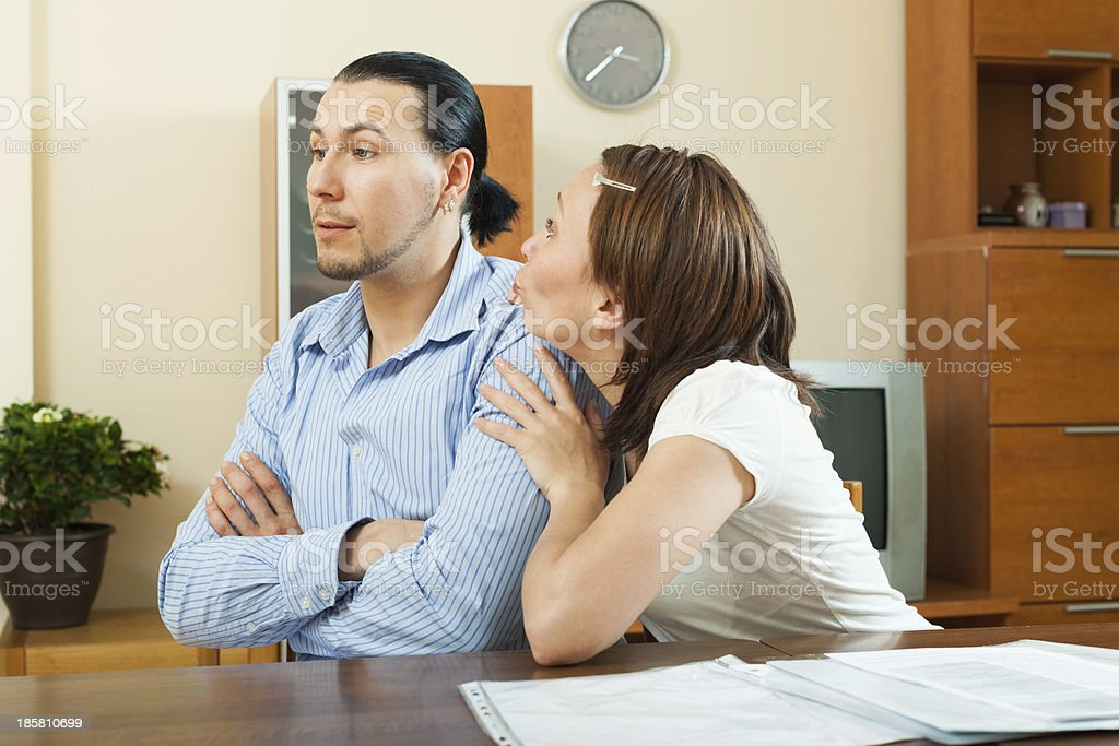 woman asking for money from  husband royalty-free stock photo