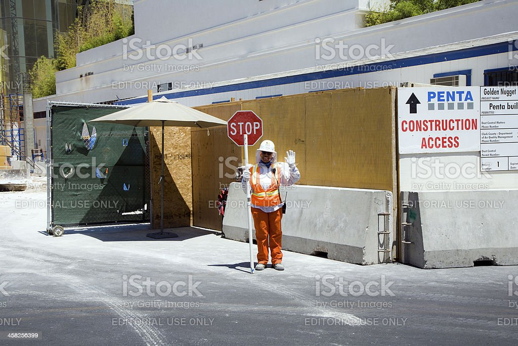 Woman assecurity guard is regulating the access royalty-free stock photo