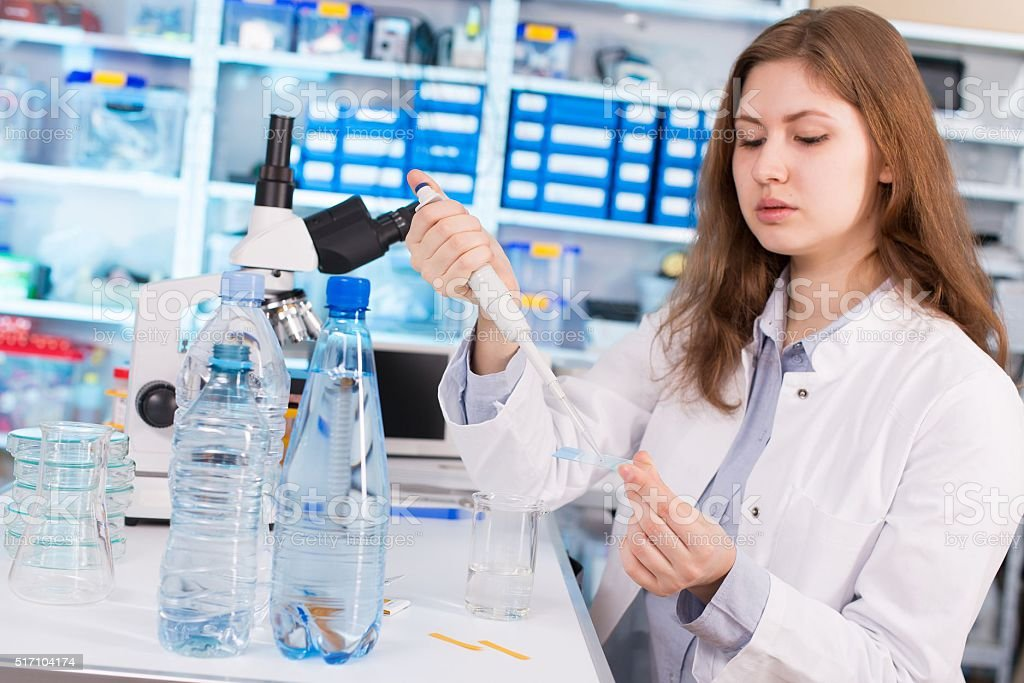 woman assistant in laboratory with multi pipette in the clinic, stock photo