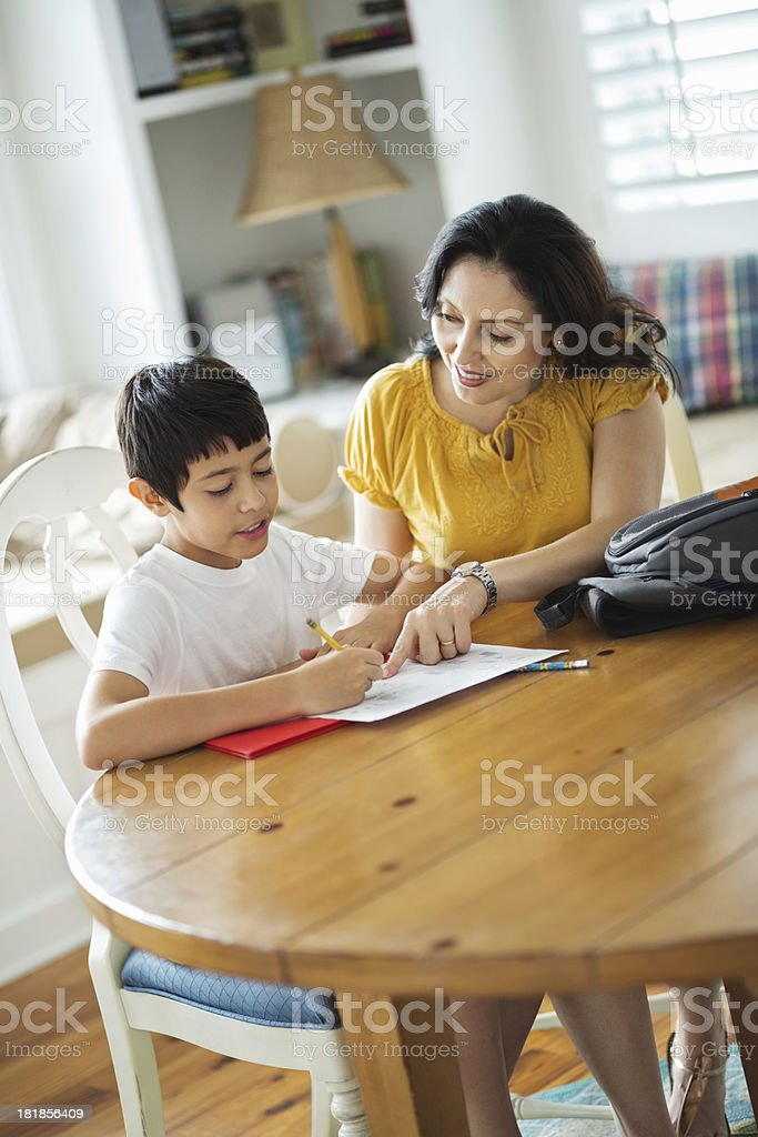 Woman Assisting Son With Homework royalty-free stock photo
