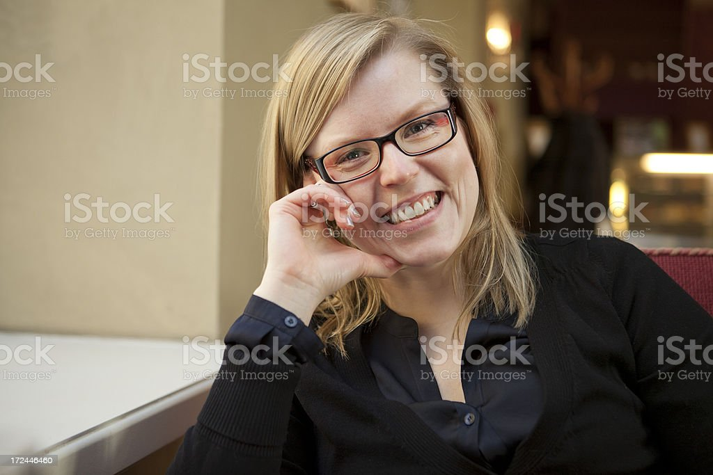 Woman at a cafe royalty-free stock photo