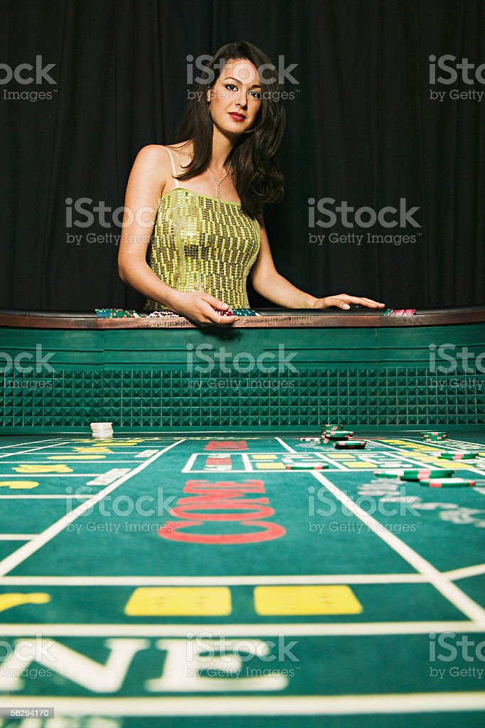Woman at a craps table stock photo