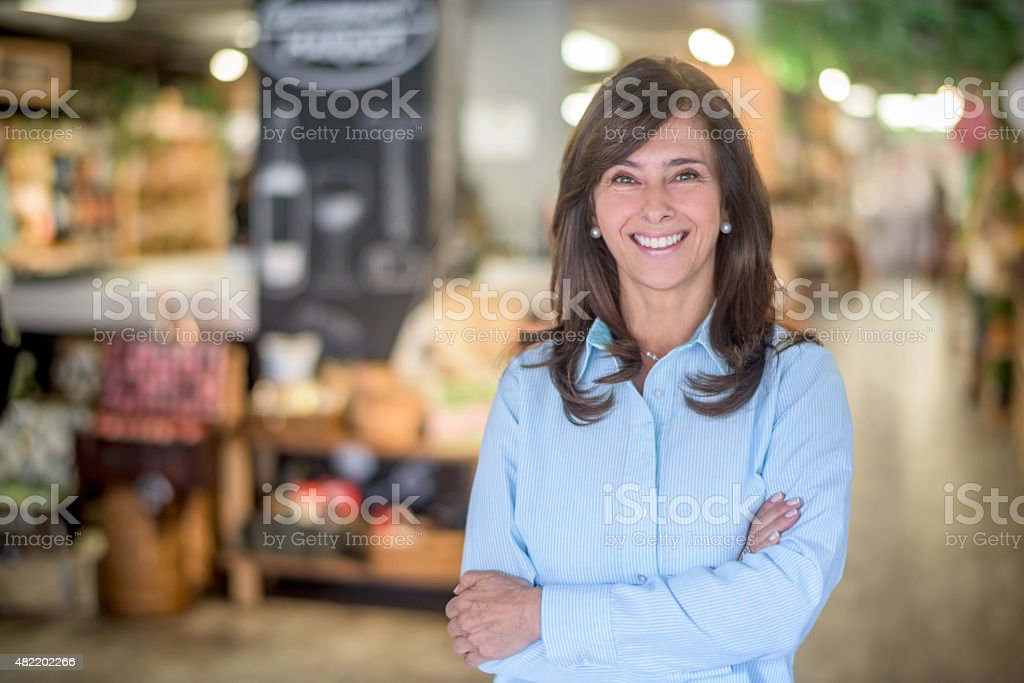 Woman at a food market grocery shopping stock photo