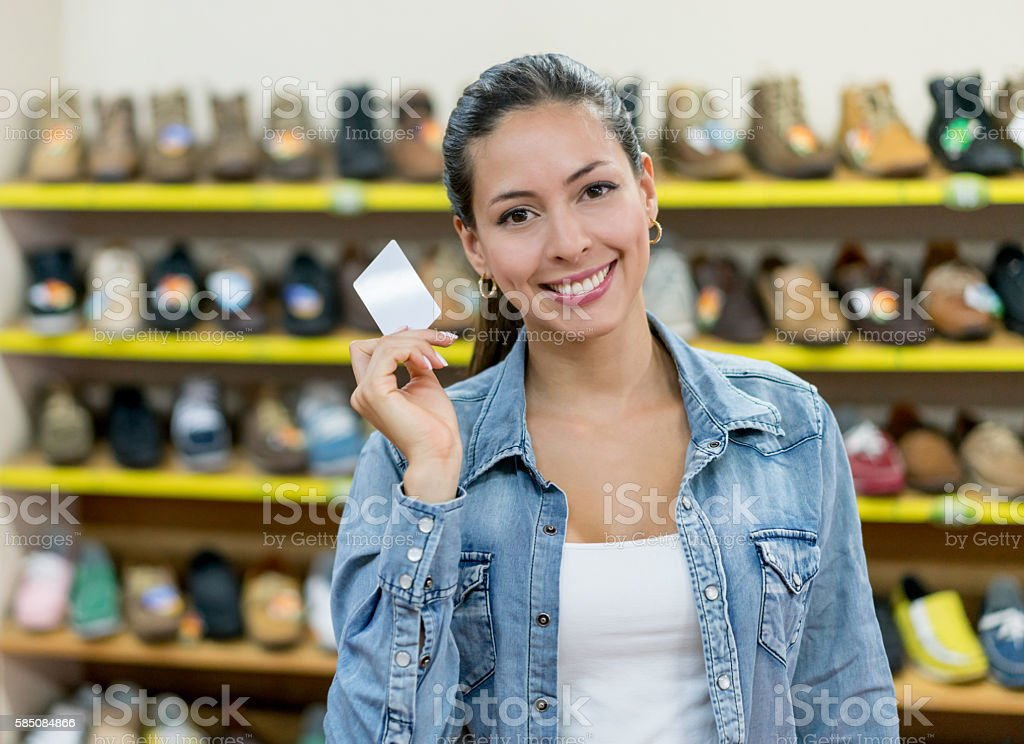 Woman at a shoe store holding a business card stock photo