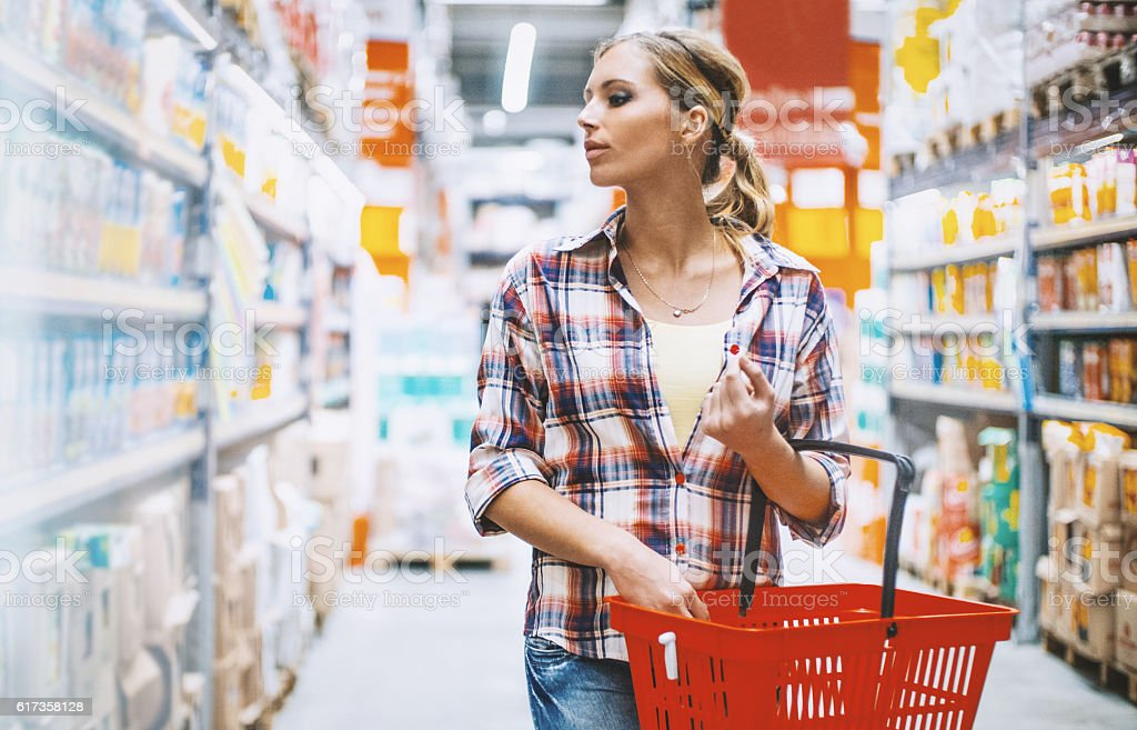 Woman at a supermarket. stock photo