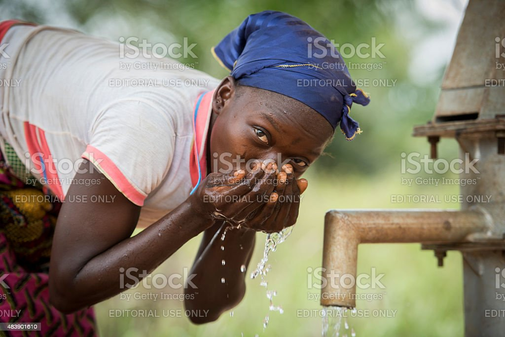 Woman at a well stock photo