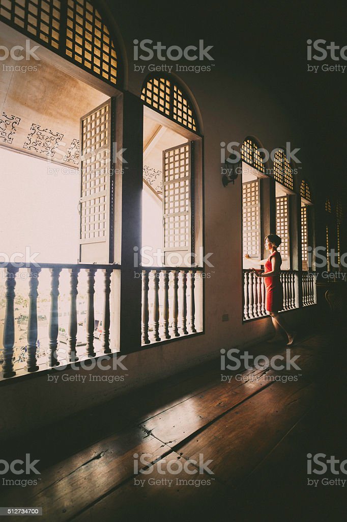 Woman at a window stock photo