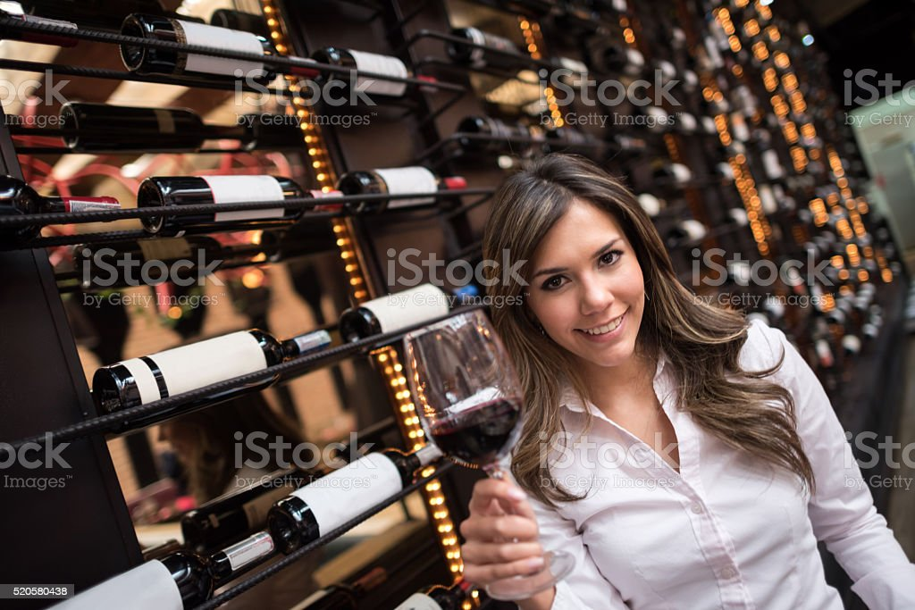 Woman at a wine cellar stock photo