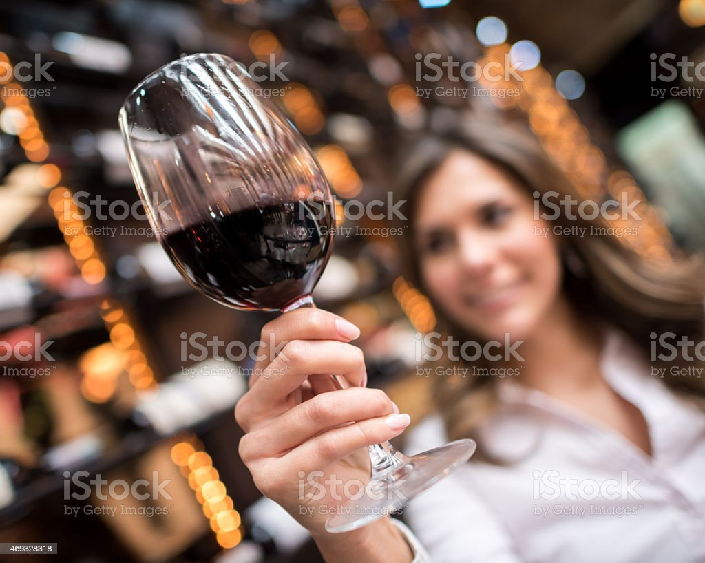 Woman at a wine taste stock photo