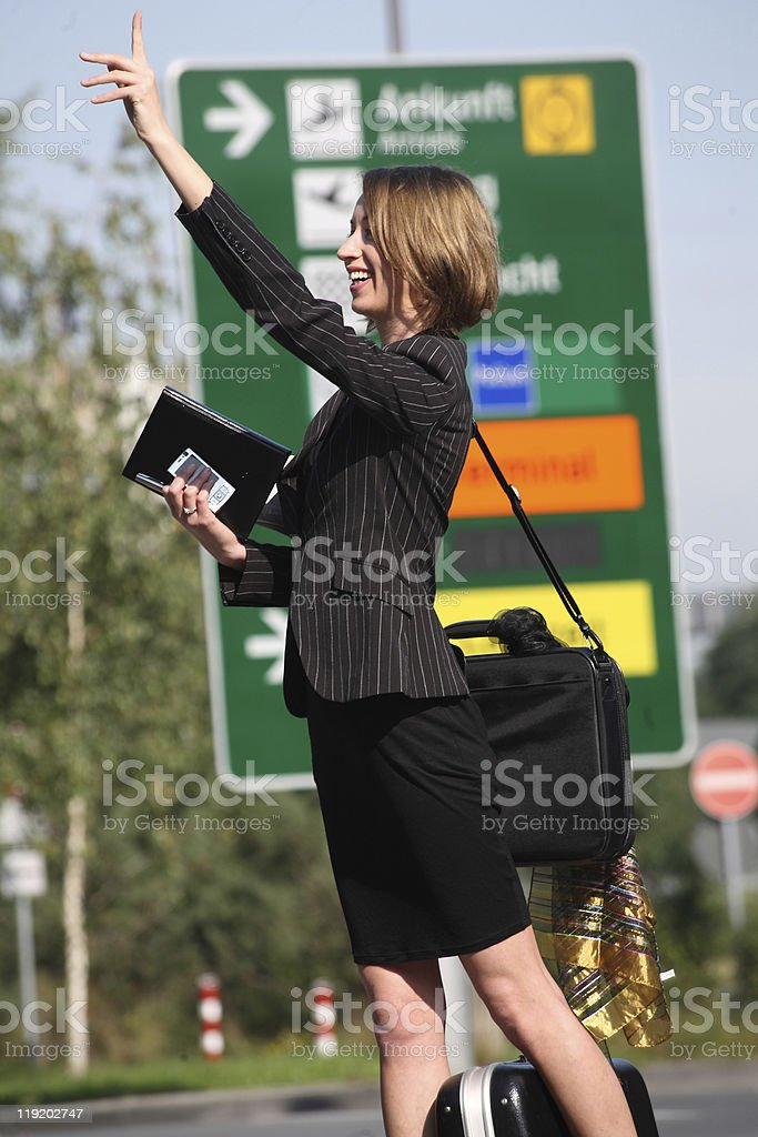 woman at airport looking for cab royalty-free stock photo