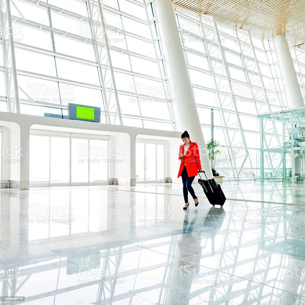 woman at airport stock photo