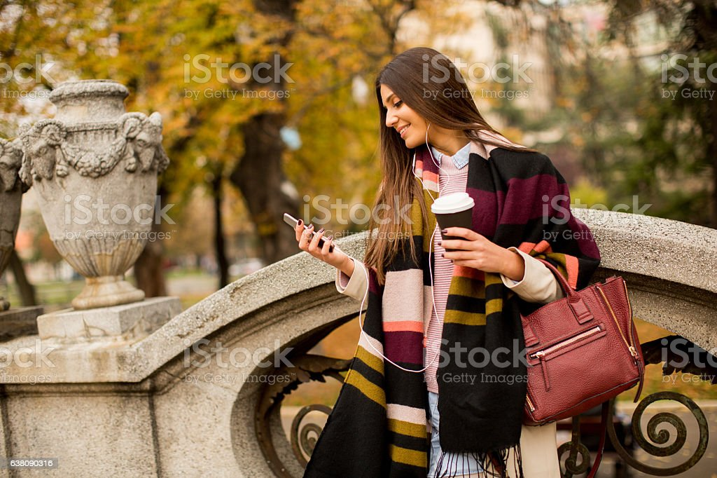Woman at autumn outdoor stock photo