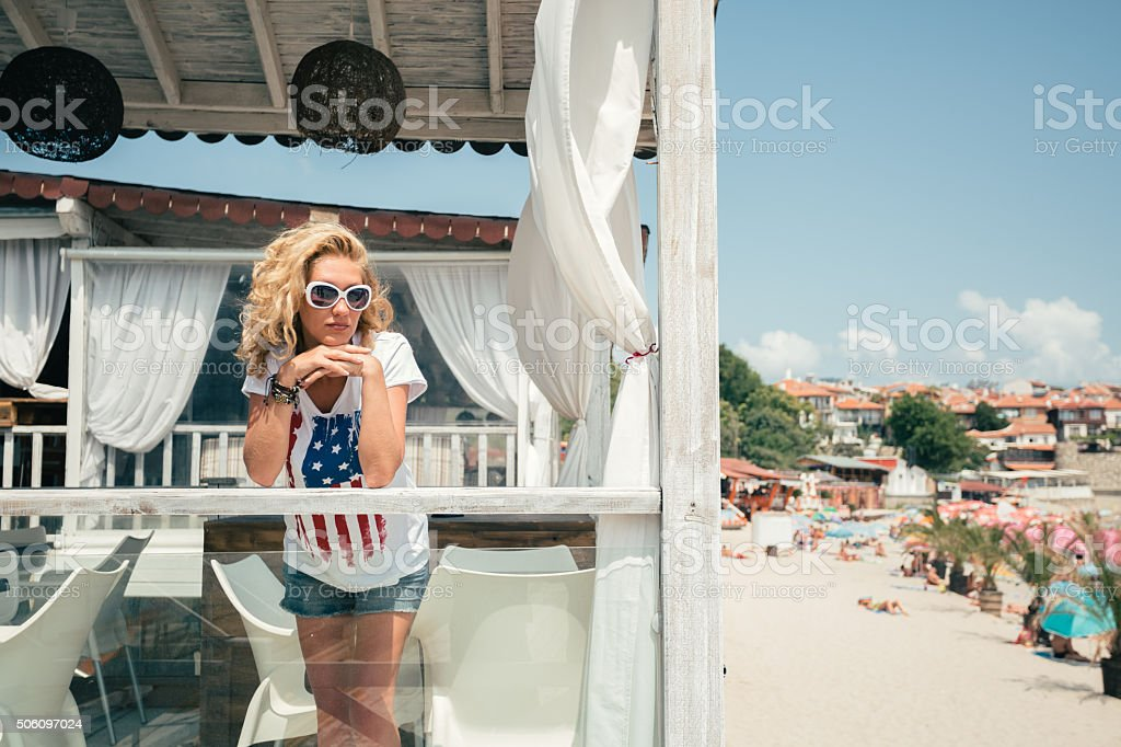 Woman at beach house in Florida stock photo