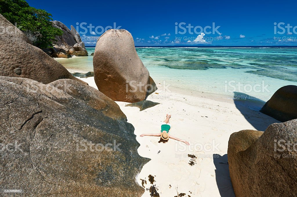 Woman at beautiful beach stock photo