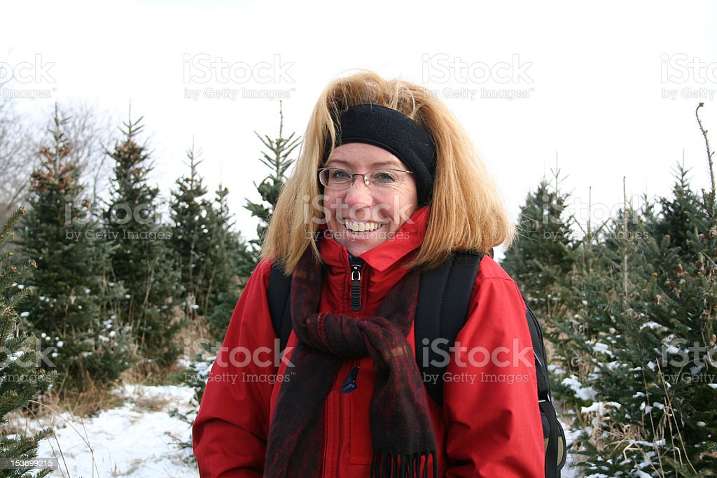 Woman at Christmas Tree Farm in Winter stock photo