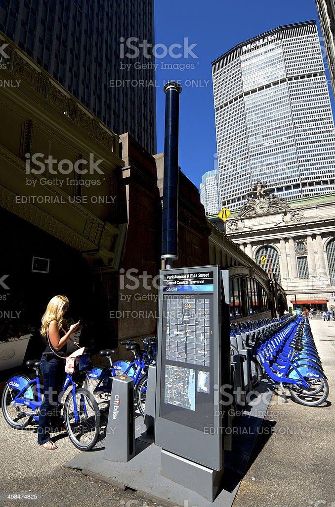 Woman at Citi Bike Station, Grand Central Terminal, Midtown, NYC royalty-free stock photo