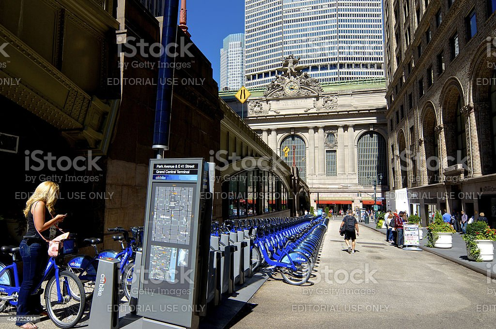 Woman at Citi Bike Station, Grand Central Terminal, Midtown, NYC royalty-free stock photo
